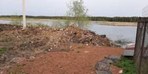 Кировские активисты выявили свалку строительных отходов в прибрежной зоне реки Сандаловки